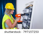 woman electrician fitting a... | Shutterstock . vector #797157253