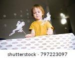 cute boy shows home theater. | Shutterstock . vector #797223097