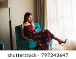 woman using mobile phone on sofa | Shutterstock . vector #797243647