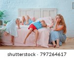 tired mother sits near the bed... | Shutterstock . vector #797264617