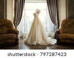 beautiful wedding dress hanging ... | Shutterstock . vector #797287423