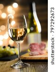 glass of white wine with french ... | Shutterstock . vector #797292673