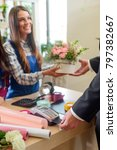 man buying a bouquet and paying ... | Shutterstock . vector #797382667