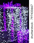 Small photo of Bokeh lighting background from light blue, purple, white, with blurred and ultraviolet bokeh, perfect for Christmas or New Year accompanying festivals.