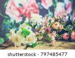 flowers on wooden background  | Shutterstock . vector #797485477