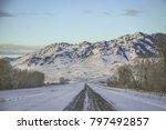 winter road waving through the... | Shutterstock . vector #797492857