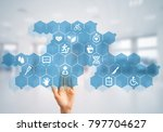 hand of woman touching icon of... | Shutterstock . vector #797704627
