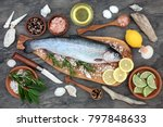 Small photo of Rainbow trout health food on an olive wood board with seasoning. Very high in omega 3 fatty acid and beneficial to maintain a healthy heart.