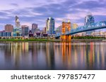 Cincinnati, Ohio, USA downtown skyline and bridge on the river at dusk.