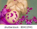 Pregnant woman taking  spa bath - stock photo