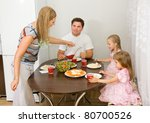 family gathers for dinner at... | Shutterstock . vector #80700526