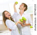 Happy Couple Eating Fresh...