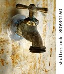 Old Rusty Garden Faucet On Wal...