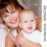 happy young mother with baby | Shutterstock . vector #80962768