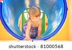 little girl crawling in a tube | Shutterstock . vector #81000568