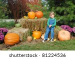 Little Boy With Big Pumpkins