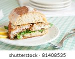 Catfish po' boy on crusty loaf - stock photo