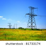 high voltage electrical power line in the field - stock photo