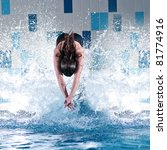 Portrait of a young woman jumping in swimming pool - stock photo
