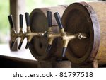 Wooden old barrels with pipe for cold and refreshing beer - stock photo