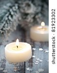 two christmas candles with decoration - stock photo
