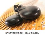 two castanets on a Spanish fan - stock photo