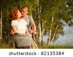 young couple sitting at one... | Shutterstock . vector #82135384