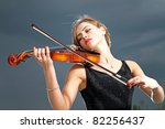 Young Girl Playing Violin Over...