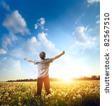 young man standing on a meadow... | Shutterstock . vector #82567510