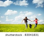 young happy couple running on a ... | Shutterstock . vector #83041831