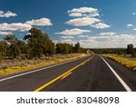 Typical American Road winding through Arizona - stock photo