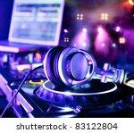 Dj Mixer With Headphones At A...