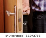 Man open the door, horizontal photo. - stock photo