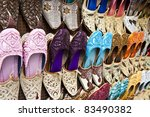 Rows of colorful shoes at the market in Dubai. - stock photo