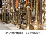 A row of shiny traditional coffee pots at the souq in Dubai. - stock photo