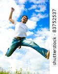 man jumping in a meadow - stock photo