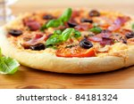 pizza with ham and tomatoes on... | Shutterstock . vector #84181324