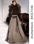 NEW YORK - FEBRUARY 15: A model walks the runway at the Dennis Basso Collection presentation for Fall/Winter 2011 during Mercedes-Benz Fashion Week on February 15, 2011 in New York. - stock photo