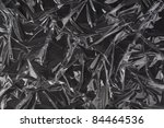 Transparent plastic foil on black background - stock photo