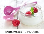 fresh natural yogurt with raspberries in a glass - stock photo