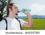 man drinking water in mountains | Shutterstock . vector #84535783