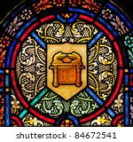 Stained glass window with symbol of Ark of the Covenant - stock photo