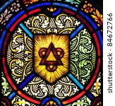 Stained glass window with triangle and circles symbolizing the Holy Trinity - stock photo