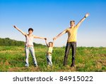 happy family in a meadow | Shutterstock . vector #84915022