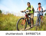 couple of cyclists riding... | Shutterstock . vector #84988714
