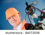 Oil Worker In Orange Uniform...