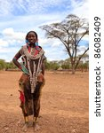 OMO VALLEY, ETHIOPIA - AUG 10: Tsemay woman posing in the village, the ethnic groups in the Omo valley could disappear because of Gibe III hydroelectric dam on Aug 10, 2011 in Omo Valley, Ethiopia. - stock photo