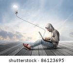 man using a laptop with light... | Shutterstock . vector #86123695