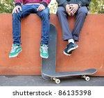 Two Friends Skateboarders In...