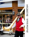 Small photo of ZERMATT, SWITZERLAND - AUGUST 14: Swiss musician with a typical Alphorn during the 2011 Folklore Summer Festival where more than 50 groups and 1,200 Swiss dancers took part on August 14, 2011 in Zermatt, Switzerland.